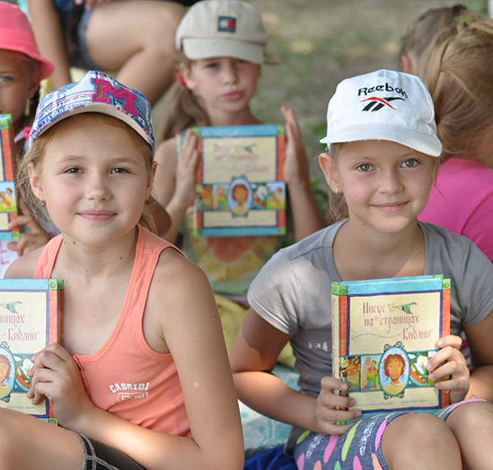 Young girls holding the Jesus Storybook Bible