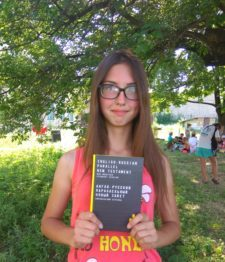 Young girl from eastern Ukraine holding Scripture
