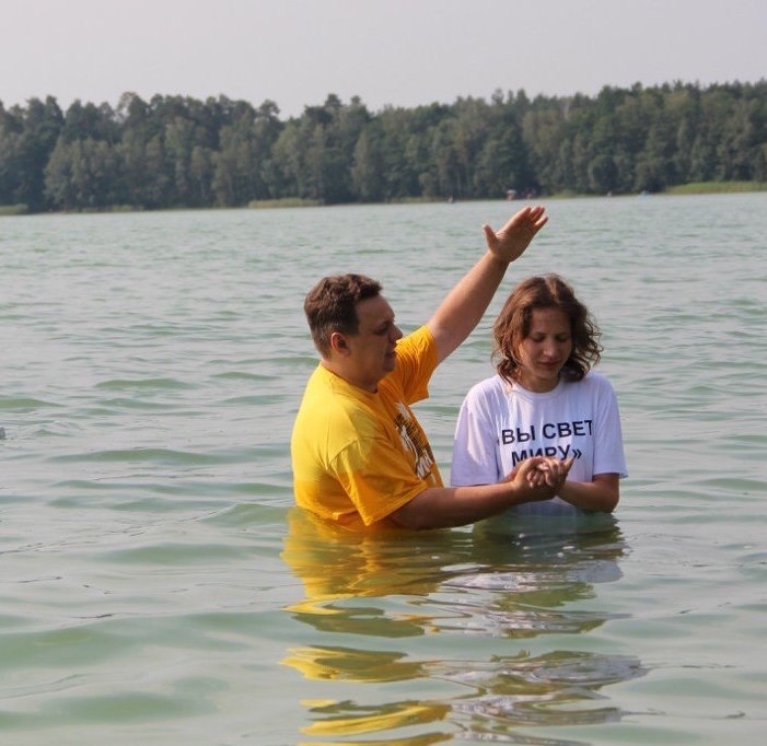Young woman being baptized in Belarus