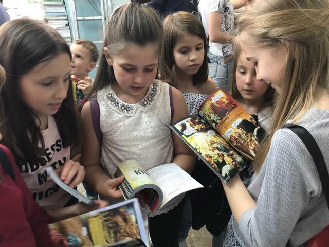 Children in Ukraine receiving Action Bible New Testaments