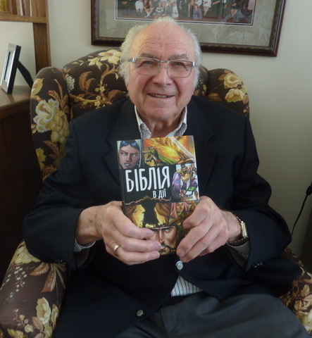 Bill Kapataniuk with a copy of the Action Bible in the Ukrainian language