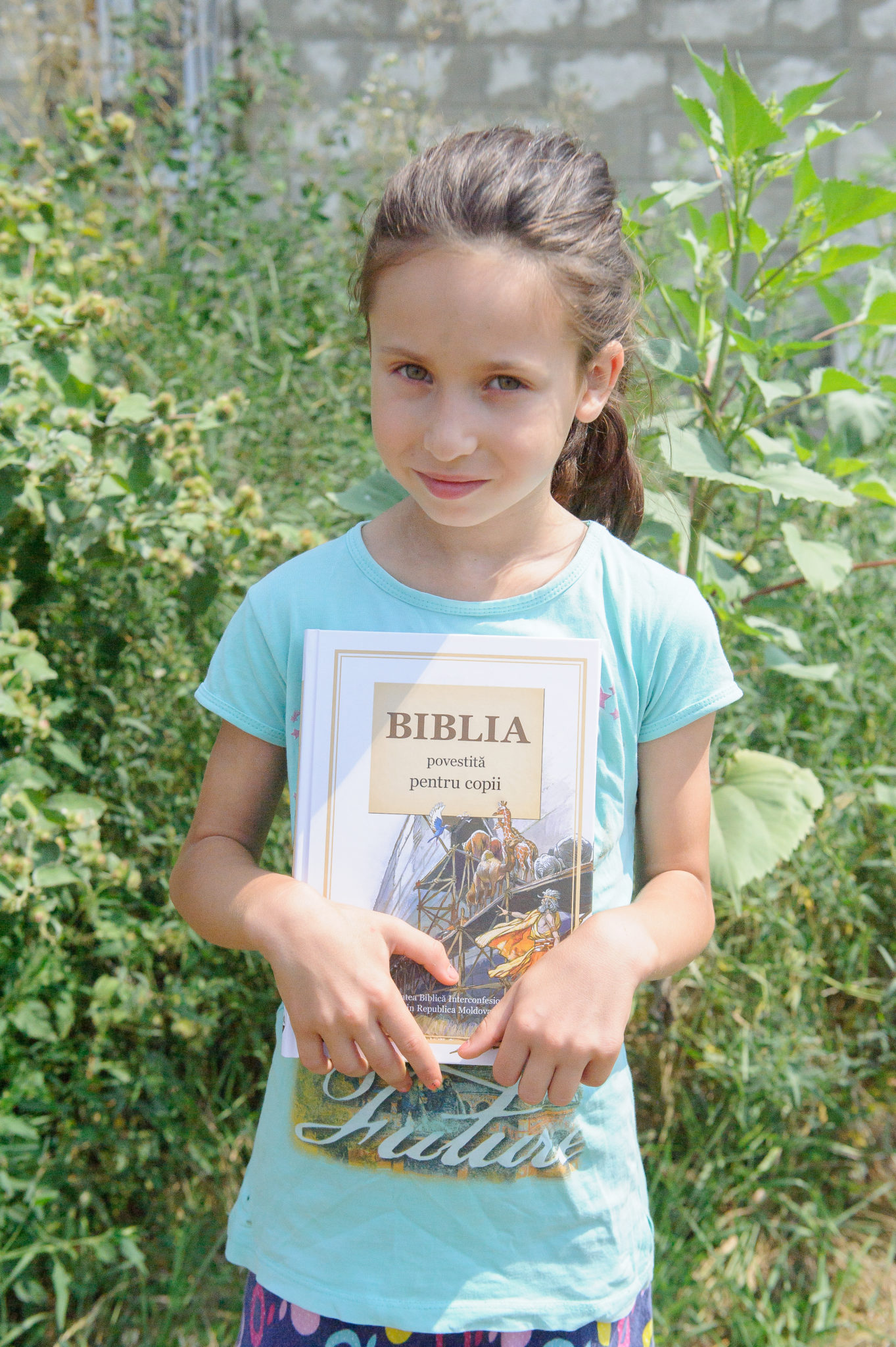 Young girl holding a New Testament
